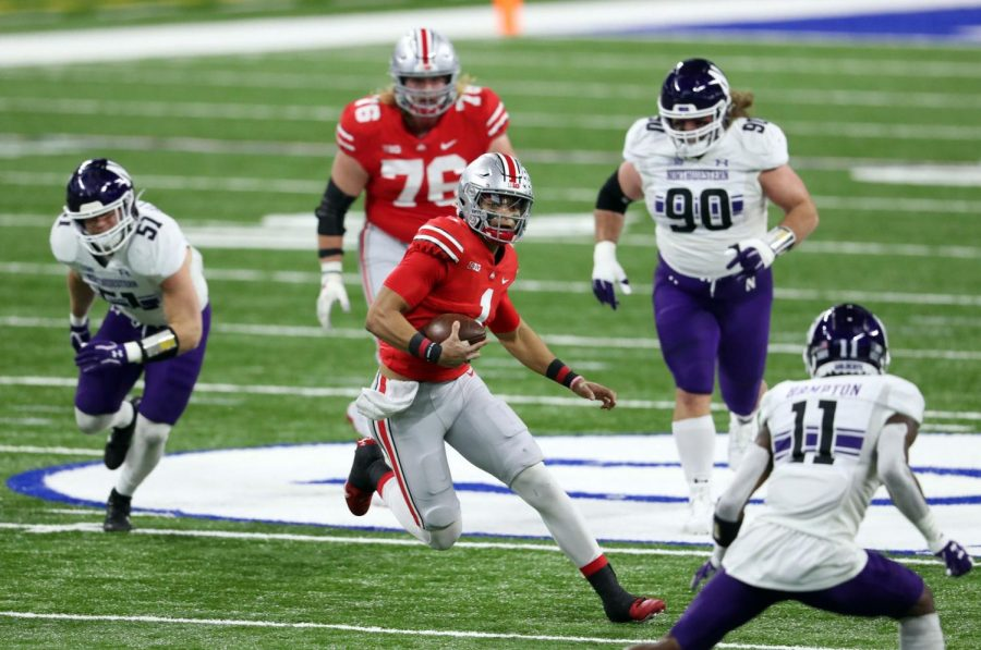 Ohio State quarterback Justin Fields runs through the Northwestern defense in the first quarter of the Big Ten Championship Game at Lucas Oil Stadium on Saturday.