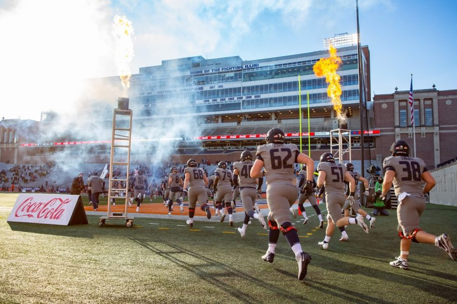 The Illinois football team takes the field at Memorial Stadium before the game against Iowa on Saturday.