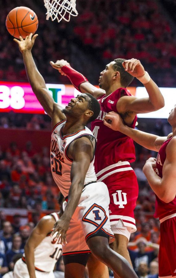 Da'Monte Williams goes up for the layup contested by Trayce Jackson-Davis in Illinois' meeting with Indiana last season on March 1. The Illini face the Hoosiers Saturday afternoon.