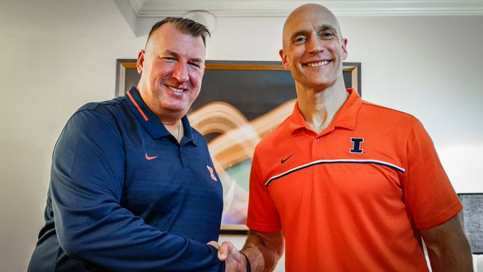 Illinois+Athletic+Director+shakes+hands+with+newly+hired+football+coach+Bret+Bielema.