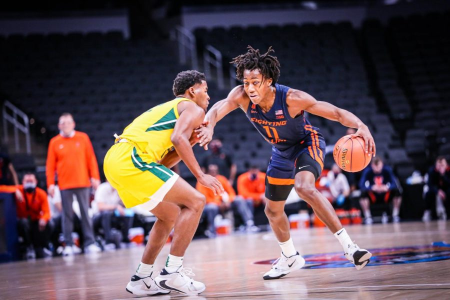 Ayo Dosunmu tries to dribble past a Baylor defender on Wednesday night in Indianapolis. The Bears defense locked down the Illini and Dosunmu in Illinois loss.