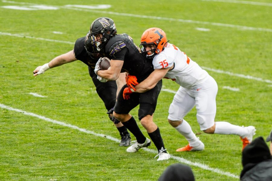 Illinois linebacker Jake Hansen tries to tackle a Northwestern player in the rivalry matchup on Saturday afternoon. The Illini lost to the Wildcats 28-10.
