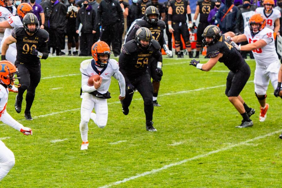 Quarterback Isaiah Williams runs the ball in Illinois' game against Northwestern Saturday afternoon. The Illini struggled in all areas of the game, falling 28-10.