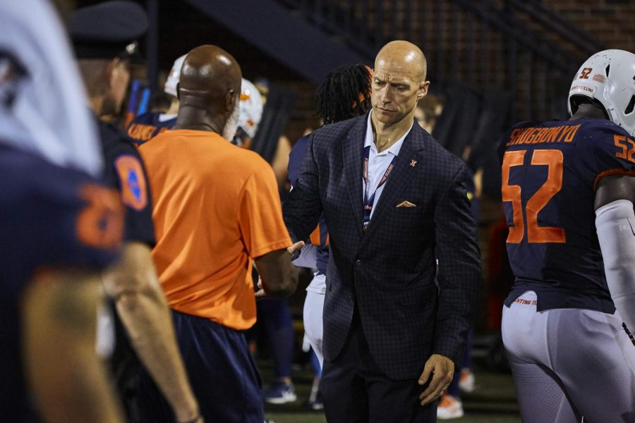 Athletic Director Josh Whitman shakes Lovie Smith's hand after a football game on Sep. 21, 2019. After five years at Illinois, Smith was fired on Sunday as a result of not winning enough games for the program.