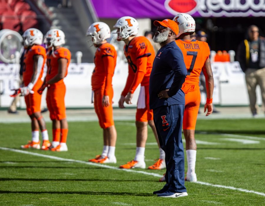 Lovie Smith stands near the Illini during warmups in the Redbox Bowl on Dec. 30. Smith has been fired as Illinois' head coach, leaving uncertainty for the future.