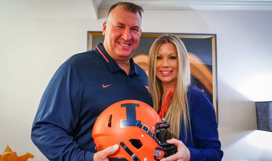 Newly hired Illinois football coach Bret Bielema poses with his wife.