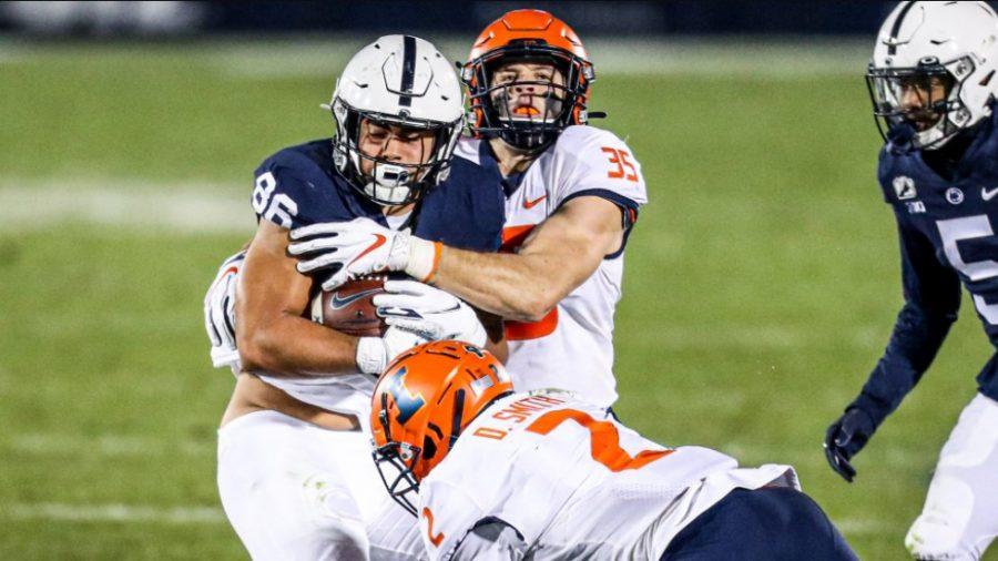 Senior Jake Hansen wraps up an opposing player during competion.