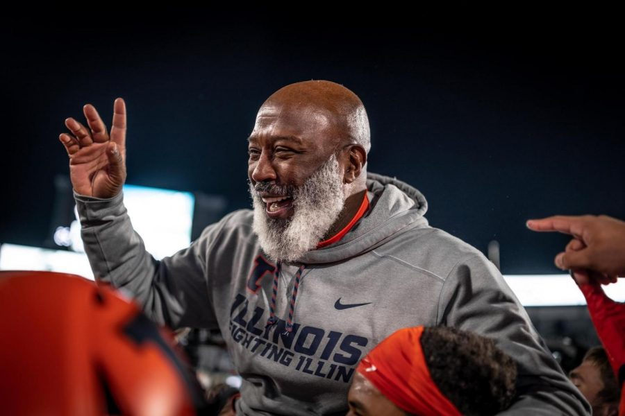 Illinois head football coach Lovie Smith celebrates after securing a 24-23 victory over Wisconsin on Oct. 19, 2019.