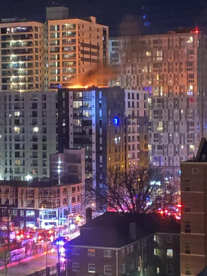 The SevenO7 apartment building burns on Thursday morning.
