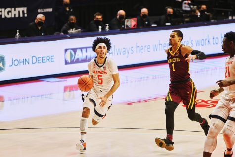 Freshman Andre Curbelo drives towards the basket during the game against Minnesota on Tuesday. The Illini won the game 92-65.