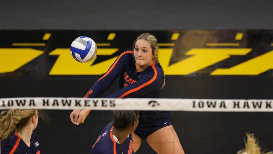Redshirt Freshman Ellie Holzman bumps the ball during the game against Iowa on Saturday.
