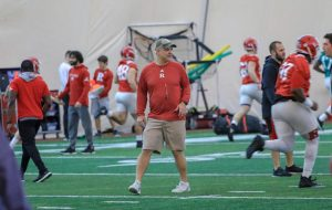 Andy Buh coaches at a Rutgers practice. Buh will work as the linebackers coach in the upcoming season for the Illinois football team.
