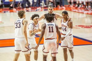 The Illinois men's basketball team huddles before a play during the game against Purdue on Jan. 2.