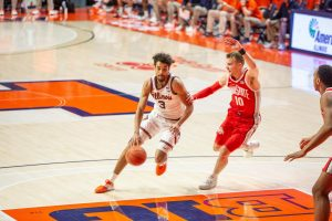 Jacob Grandison dribbles by an Ohio State defender in the Illini's loss to the Buckeyes on Saturday.