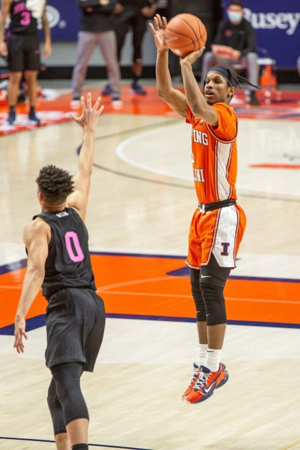 Senior Trent Frazier shoots a three during the game against Penn State on Tuesday. The Illini won the game 79-65.