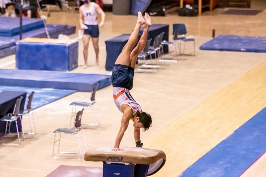 Sophomore Evan Manivong competes in the vault event during the meet against Ohio State on Saturday.