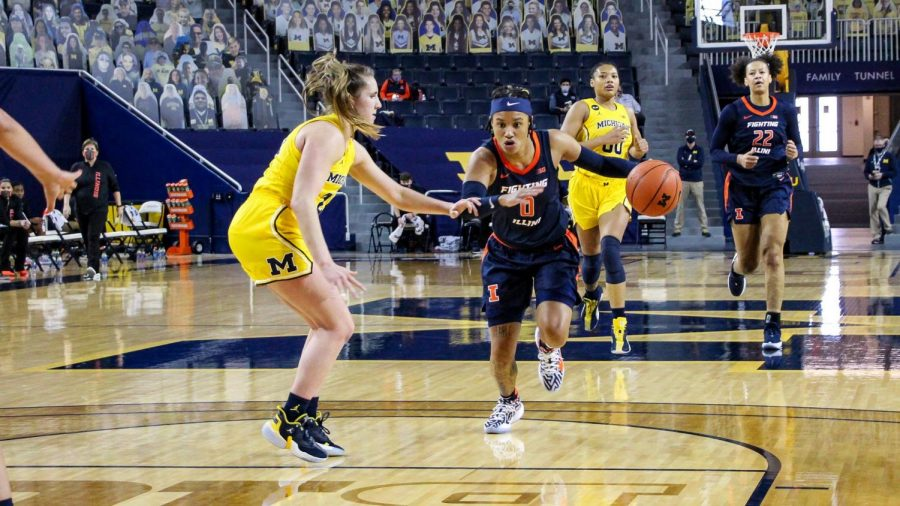 J-Naya Ephraim drives to the basketball during Illinois' game at Michigan Sunday. The Illini fell 70-50