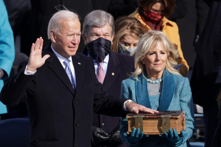 President Joe Biden takes the oath of office from Supreme Court Chief Justice John Roberts as his wife, First Lady Jill Biden, stands next to him during the 59th presidential inauguration in Washington, D.C., on Wednesday.