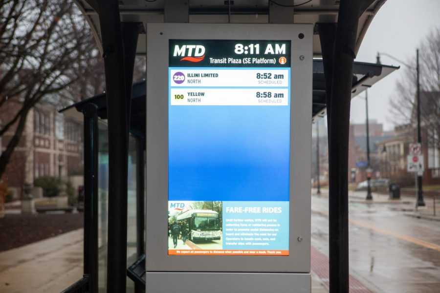 An MTD terminal on Wright Street informs riders when the next buses are coming on Sunday morning. MTD has recently reduced their service.
