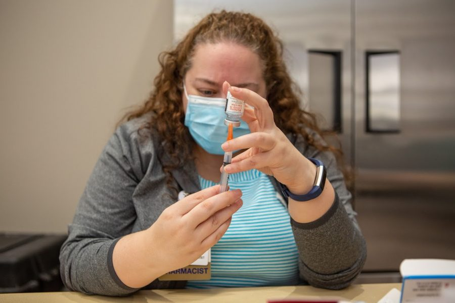 Pharmacist Katie Lampan prepares shots of the Moderna COVID-19 vaccine on Jan. 12. Vaccine supplies are currently limited to older and at-risk citizens.
