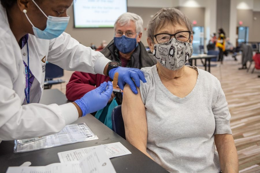 A senior Champaign County resident receives the Moderna COVID-19 vaccine on Jan. 12 at the I-Hotel. The Champaign-Urbana Public Health District has recently expanded vaccinations to individuals who are 65 or older and have underlying health conditions.