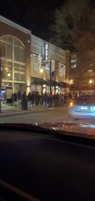 Patrons of Chipotle wait outside the restaurant on Monday night. The recent Massmail sent by Robert Jones encourages students to take precautions against COVID-19