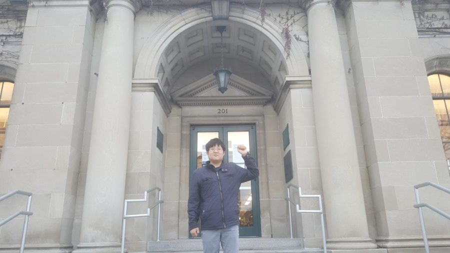 Urbana mayoral candidate Andy Ma poses outside of the Urbana Free Library on Dec. 19. The primary election will occur on Feb. 23.