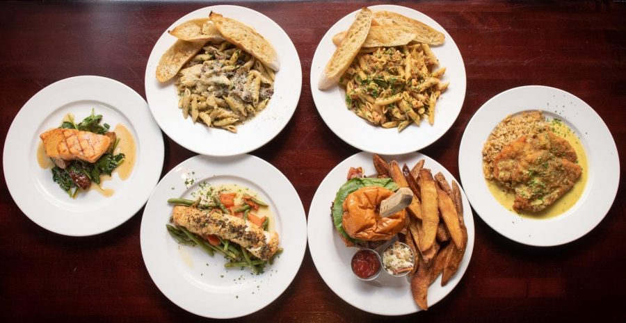 A sampling of six dishes from Hamilton Walkers lay on a table. The Champaign County Area Restaurant Week will run from Jan. 29 to Feb. 6.