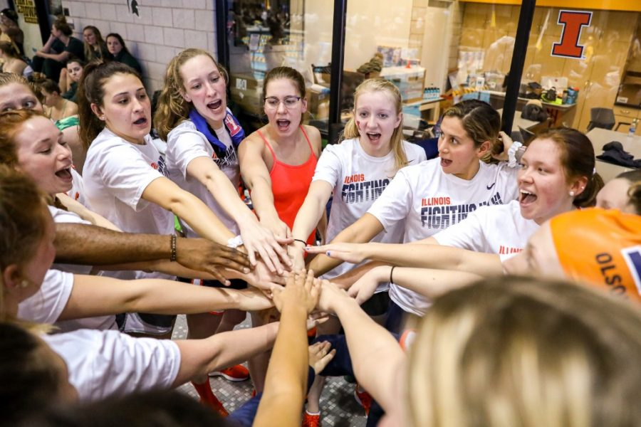 The Illini swim & dive team finishes a huddle during the 2020 Big Ten Championships on Feb. 26. Assistant coach Elliott McGill has helped the team keep morale up during this shortened season.