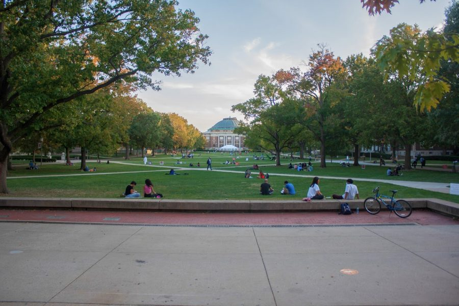 Students sit on the Main Quad on Oct. 8. In January 2021, at least 16 COVID-related deaths occurred in Champaign County, the majority being 70 years old or older.