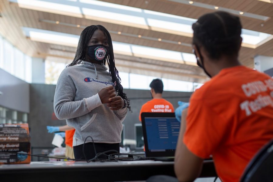 Jessica Osemwngie checks in at the COVID-19 testing site at State Farm Center on Oct. 9. This past week, 179 new cases of COVID-19 were identified from Jan. 16-22 after nearly 58,000 tests.