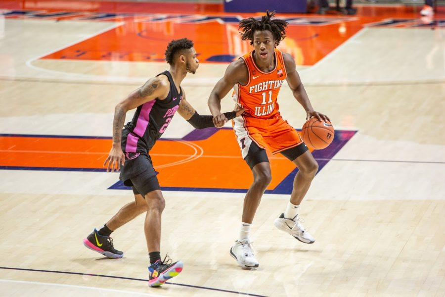 Junior Ayo Dosunmu looks to pass during the game against Penn State on Jan. 19. Dosunmu has recently made the top 10 list to receive the Bob Cousy Point Guard of the Year Award.
