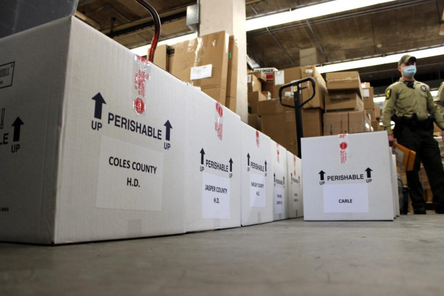 Shipments of the Pfizer-BioNTech vaccine arrive at Carle Foundation Hospital on Dec. 16. Some Champaign County residents 75 and older will receive COVID-19 vaccines this week.