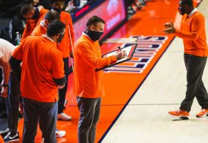 Illinois coach Brad Underwood plans a play on the sidelines during the game against Purdue on Jan. 2. The Illini will face off against the Maryland Terrapins today.