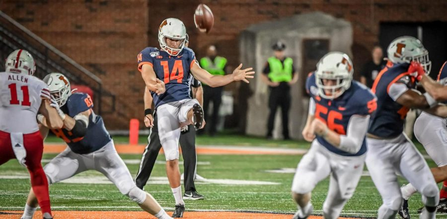 Senior Blake Hayes kicks a punt during a game against Nebraska. Hayes, along with snapper Ethan Tabel and kicker James McCourt will return to the Illinois football team next season.