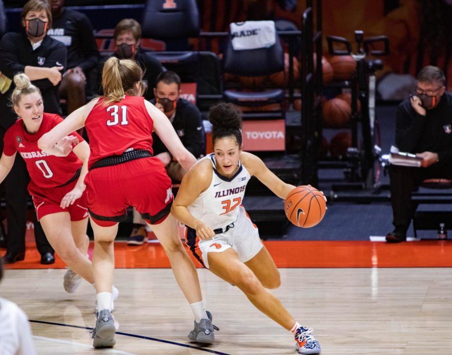 Aaliyah Nye dribbles past a defender in Illinois' game against Nebraska on Monday. The Illini lost 57-53.