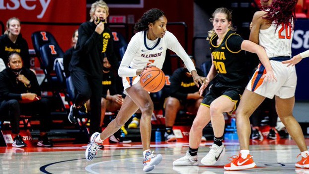 Lyric Robins dribbles the ball in Illinois