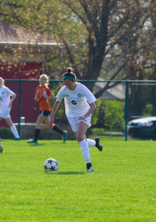 Mackenzie Schuler kicks the ball in Peoria Notre Dames game against Normal Community. Schuler recently joined the Illinois soccer team as a walk-on.