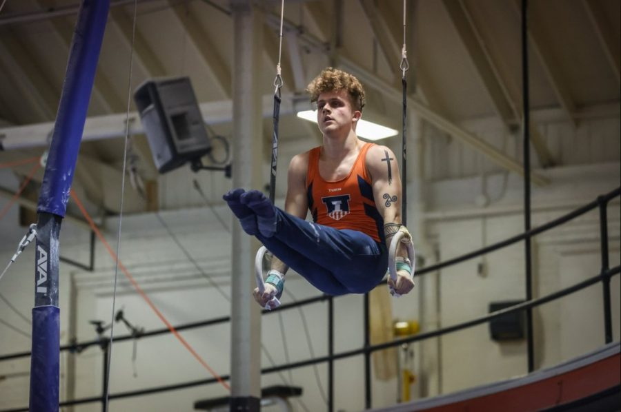 Freshman Logan Myers competes in the rings event during the meet against Northern Illinois on Friday.