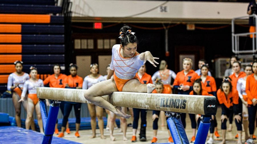 Sophomore Mia Takekawa performs her balance beam routine during competition.