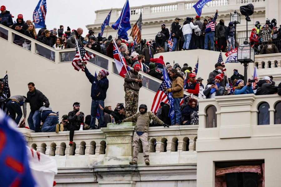 Pro-Trump supporters storm the U.S. Capitol following a rally with President Donald Trump on Wednesday in Washington, D.C. Congress held a joint session to ratify President-elect Joe Biden