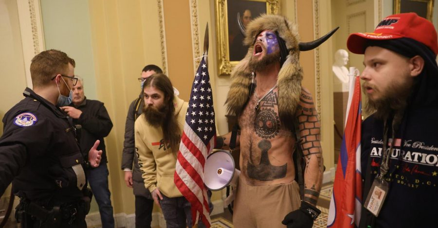 Supporters of President Donald Trump interact with Capitol Police inside the U.S. Capitol Building amid a riot in Washington, D.C., on Wednesday.