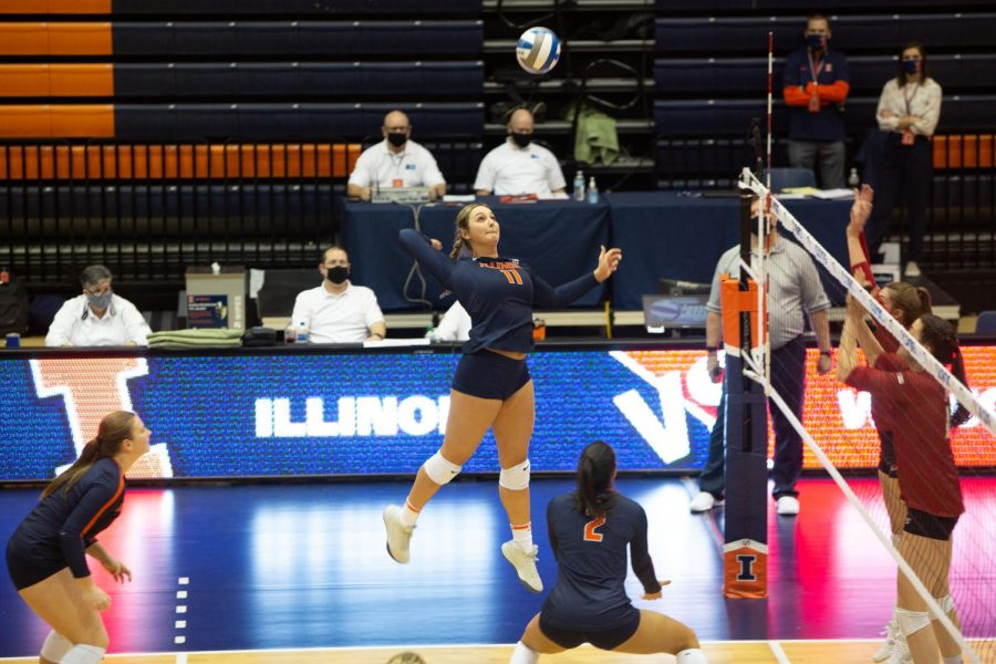 Redshirt freshman Ellie Holzman winds up to spike the ball during the game against Wisconsin on Friday. The Illini lost their two matches against the No.1 ranked Wisconsin 3-0 and 3-1 this weekend.