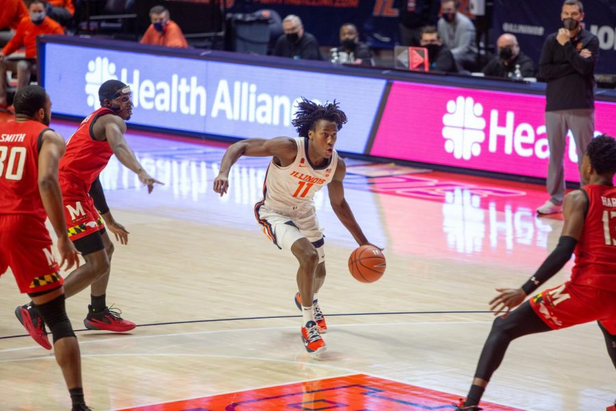 Ayo Dosunmu drives to the lane during Illinois' game against Maryland Jan. 10. Dosunmu declared for the 2021 NBA Draft Tuesday afternoon.