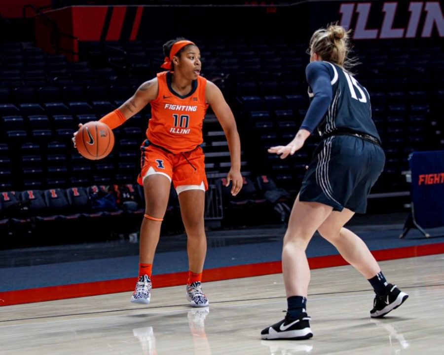 Sophomore guard Jeanae Terry looks to pass during the game against Penn State on Thursday. The Illini fell to Penn State 80-76.