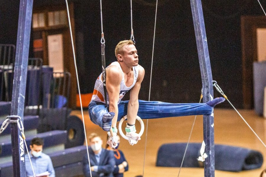 Junior Hamish Carter competes in the rings event during the meet against Ohio State on Jan. 23. The Illini will face off in a tri-meet against Michigan and Nebraska today.