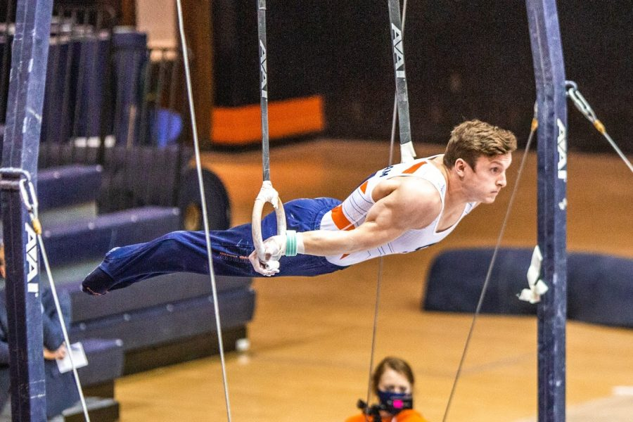 Graduate student Danny Graham competes in the rings event during the meet against Ohio State at Huff Hall on Jan. 23. The Illinois men's gymnastics team fell to Penn State on Sunday in a narrow loss.
