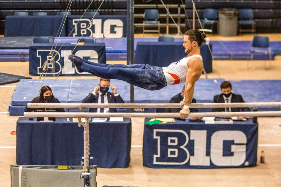 Junior Clay Mason Stephens performs his parallel bars routine during the meet against Ohio State on Jan. 23. Illinois will face Iowa this Saturday.