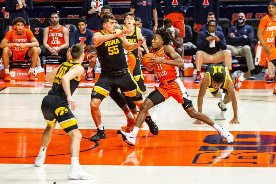 Ayo Dosunmu drives to the basket in Illinois' game against Iowa on Jan. 29.