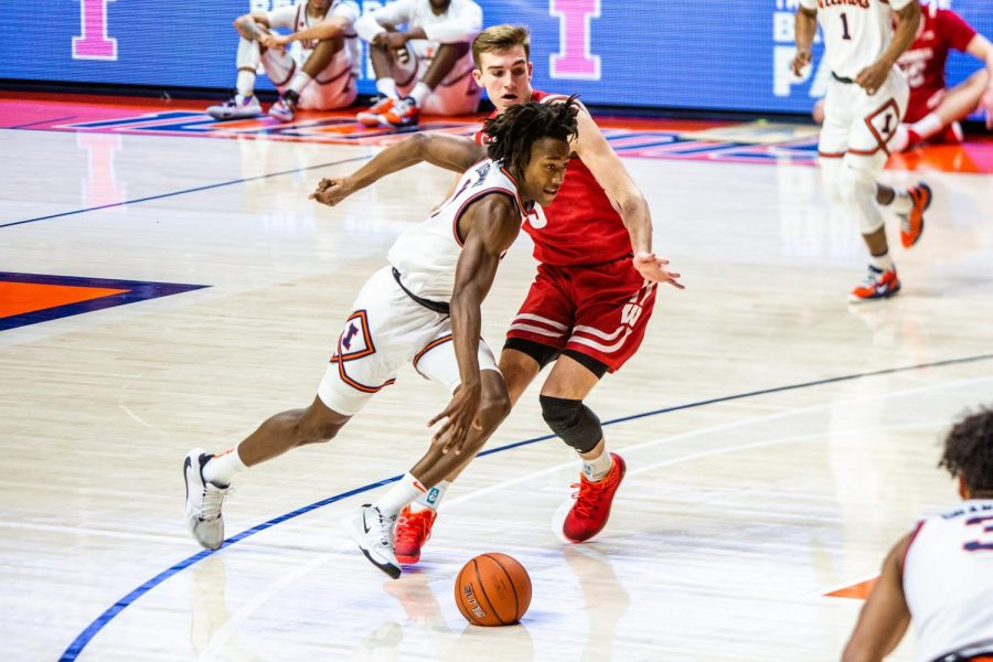 Ayo+Dosunmu+dribbles++past+a+Wisconsin+defender+in+Illinois%27+game+on+Saturday.+The+Illini+won+75-60.